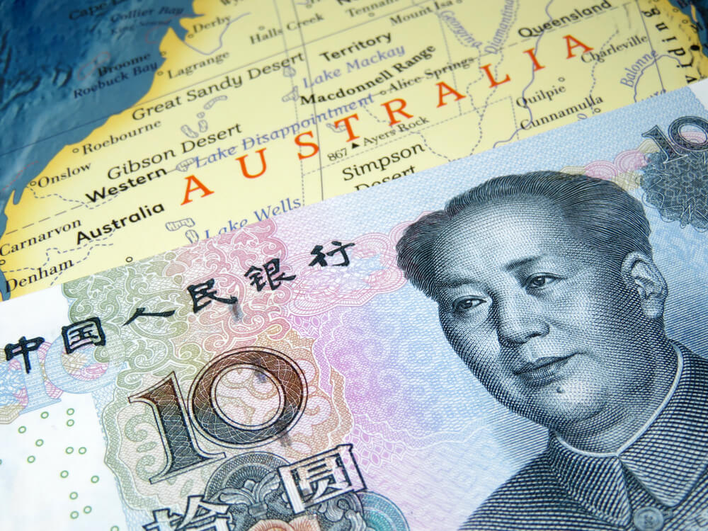 Wibest Broker-Currency Pairs: Yuan banknote on top of Australia map