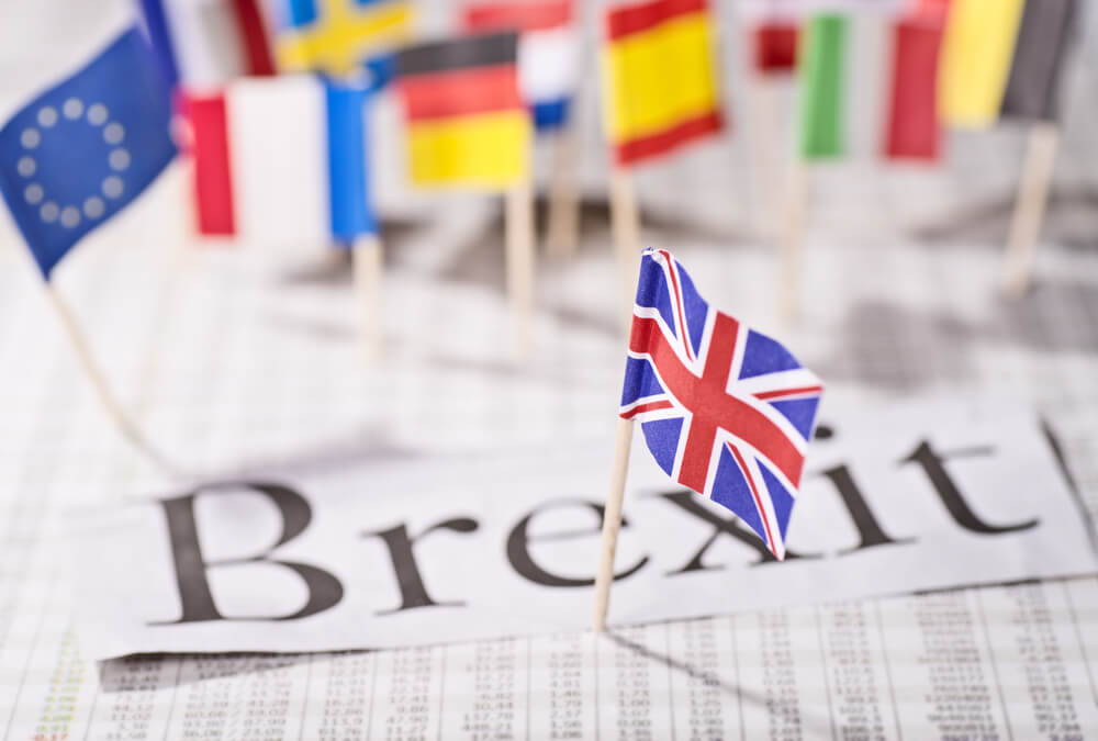 Wibest Broker — Monetary Policy: Brexit word with England flag and different countries flags background.