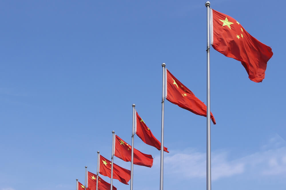 Wibest – Finance: China's flags under blue sky.