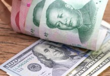 Wibest – US dollar banknotes face up to Chinese Yuan banknotes.