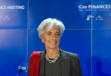 Christine Lagarde with blue background.
